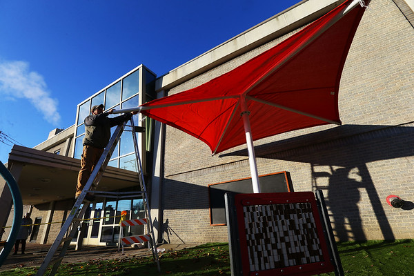 Herb Hopkins helps friend Misha Jefferson owner of Backyard Gardners installing a kids play area at the Kokomo Howard County Public Library on December 5, 2019.<br /> Tim Bath | Kokomo Tribune