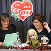 WWKI's Sherry Foxx, left, and Tammy Lively read off the descriptions of items to be auctioned off in one of the final bid lots of the 2019 We Care telethon on Sunday, December 8, 2019.<br /> Kelly Lafferty Gerber | Kokomo Tribune