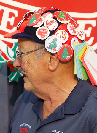 Jim Myers, from Phi Delta Kappa, shows off his hat covered in We Care pins dating back to the 70s during the check presentations at the 2019 We Care telethon on Sunday, December 8, 2019.<br /> Kelly Lafferty Gerber | Kokomo Tribune