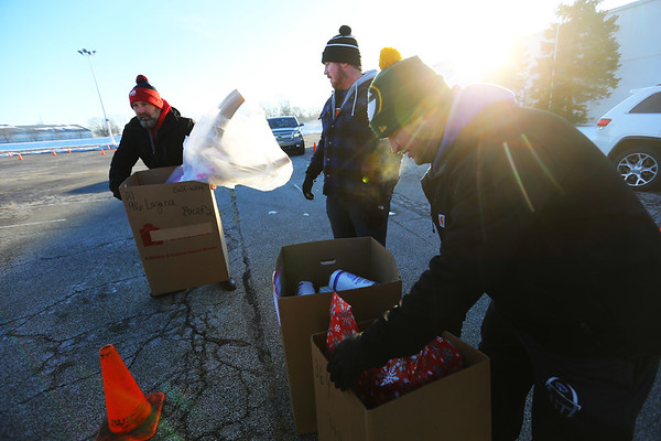 Hundreds of volunteers gather at GM to help deliver presents during the Rescue Mission Red Ribbon Christmas event on December 19, 2019.<br /> Tim Bath | Kokomo Tribune