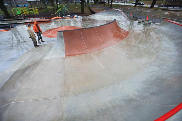 Asher Bennington and Alex Vasquez from Hunger Skateparks asses the final touches on the new skatrpark in Foster Park on December 9, 2019.<br /> Tim Bath | Kokomo Tribune