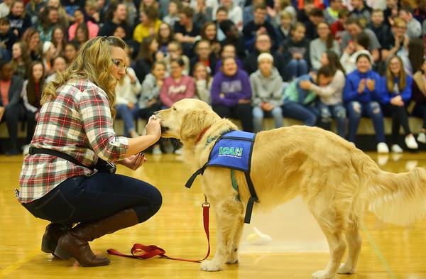 Northwestern Middle School special education teacher and Rocky's handler, Paula Davis introduces Rocky, Northwestern Middle School's new facility dog, to the school on Friday, December 13, 2019.<br /> Kelly Lafferty Gerber | Kokomo Tribune