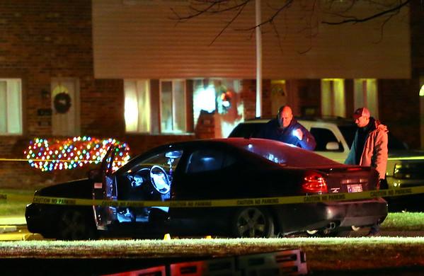 A shooting has left one person dead at Lincolnwood Apartments on Sunday December 8, 2019. Kokomo Police investigators work the scene near a dark colored Grand Prix on Longwood Drive.<br /> Tim Bath | Kokomo Tribune