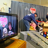 Volunteers Ben Robertson, left, and Terry Finley clear the items off of a bid lot as WWKI's Sherry Foxx and Tammy Lively share the winning bids on TV during the 2019 We Care telethon on Sunday, December 8, 2019.<br /> Kelly Lafferty Gerber | Kokomo Tribune