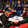 Granddaughter JoAnna Daily holds up the cake for WW II veteran Charlie Ormsby to blow out the candles at his 100th birthday party at the VFW 1152 hall on December 28, 2019. <br /> Tim Bath | Kokomo Tribune