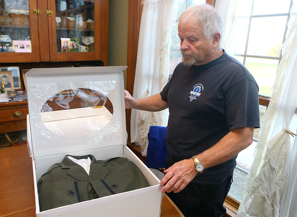"Denny Clelland, nephew of Billy Hobbs shows some of Hobbs' uniform jackets on December 3, 2019. Kokomo native Ensign Wright ""Billy"" Hobbs was one of the last four men to die in World War II in the final Pacific air battle on August 15, 1945. Hobbs' story is the subject of a new book by John Wukovits called Dogfight Over Tokyo.<br /> Kelly Lafferty Gerber 