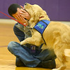 Rocky, Northwestern Middle School's new facility dog, consoles Northwestern Middle School teacher Mike Wise with nuzzles and kisses as Wise pretends to cry, demonstrating how Rocky will react to that situation as a facility dog as he is introduced to the school on Friday, December 13, 2019.<br /> Kelly Lafferty Gerber | Kokomo Tribune