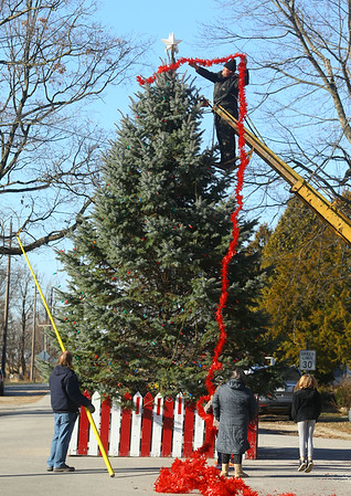 The residents of Miami, Indiana continue an 80-year tradition of putting up a Christmas tree in the middle of town, at the intersection of Elm and and Fulton streets on Saturday, December 7, 2019.<br /> Kelly Lafferty Gerber | Kokomo Tribune
