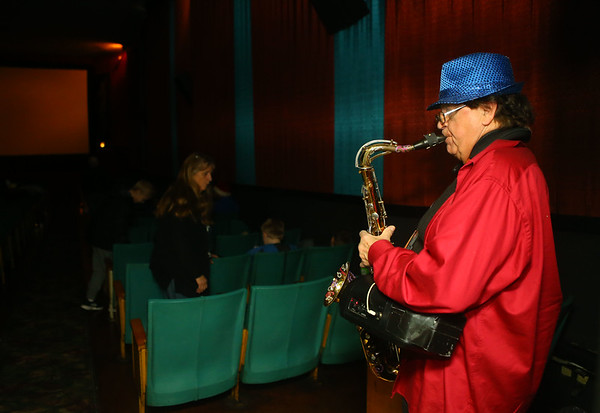 """Gary Wagner plays Christmas tunes on the tenor saxophone before the start of Diana Theatre's 93rd annual free Christmas movie, """"Wonder Park,"""" in Tipton on Saturday morning, December 21, 2019.<br /> Kelly Lafferty Gerber 