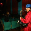 """Gary Wagner plays Christmas tunes on the tenor saxophone before the start of Diana Theatre's 93rd annual free Christmas movie, """"Wonder Park,"""" in Tipton on Saturday morning, December 21, 2019.<br /> Kelly Lafferty Gerber   Kokomo Tribune"""