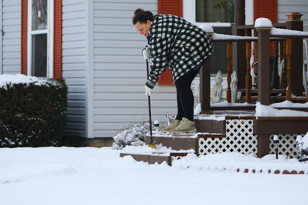 Snowfall on Monday morning slowed down the morning start only long enough for the cleanup by Dawn Wadner in the 1400 block of South Jay on Dec. 16, 2019. <br /> Tim Bath | Kokomo Tribune
