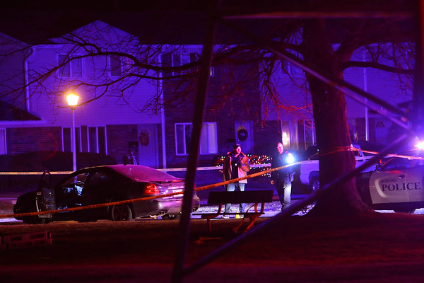 A shooting has left one person dead at Lincolnwood Apartments on Sunday December 8, 2019. Kokomo Police investigators work the scene near a dark colored Grand Prix on Longwood Drive.<br /> Tim Bath   Kokomo Tribune