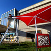 Herb Hopkins helps friend Misha Jefferson owner of Backyard Gardners installing a kids play area at the Kokomo Howard County Public Library on December 5, 2019. The canopy cover is stretched out before it is secured to the base.<br /> Tim Bath | Kokomo Tribune