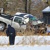 Kokomo Police accident investigator Troy Hintz measures the distance the pickup truck traveled off North Washington before it struck the tree leaving one person dead on December 17, 2019. The vehicle was traveling northbound in the 2700 block left the road sometime last evening. Tracks are visible but snow covered indicating that the accident occurred before the snow fell overnight.<br /> Tim Bath | Kokomo Tribune