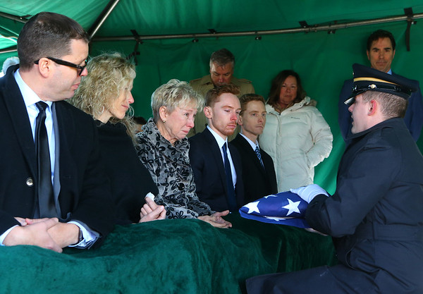 Tami Brown, center, Don Havens' wife, receives the folded flag from her husband's casket as she is surrounded by Havens' children Josh and Ali, left, and stepsons Patrick and Robert, right, during the burial service for Tipton mayor Don Havens on Saturday, December 21, 2019.<br /> Kelly Lafferty Gerber | Kokomo Tribune