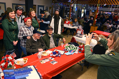 Family members pose with Charlie Ormsby during a birthday party for the 100 year-old WWII veteran at the VFW 1152 hall on December 28, 2019.  Tim Bath | Kokomo Tribune