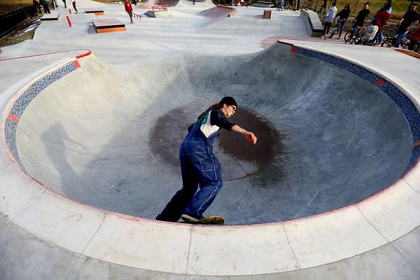 Freddie Johnson rides through the bowl at the City of Kokomo's newest skate park located at Foster Park opens to a big crowd on December 23, 2019.<br /> Tim Bath | Kokomo Tribune