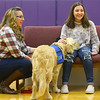 Northwestern Middle School special education teacher and Rocky's handler, Paula Davis, left, demonstrates with seventh grader Lexi Closson, right, how Rocky will interact with students as a facility dog on Friday, December 13, 2019.<br /> Kelly Lafferty Gerber | Kokomo Tribune