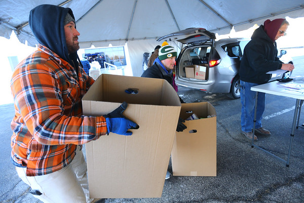 Alex Eldridge and Dylan Spesard loading boxes of gifts into vehicles at GM to be delivered during the Rescue Mission Red Ribbon Christmas event on December 19, 2019.<br /> Tim Bath | Kokomo Tribune