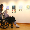 "Professor Brooke Komar wheels Waterford Place resident and artist Eileen Wade through the ""Art of Alzheimer's Disease"" exhibit to look at Wade's art and the art of her fellow residents at the IUK art gallery inside the student center on Wednesday, Jan. 16, 2019. Several Waterford Place residents were part of an art therapy program spearheaded by Professor Komar.<br /> Kelly Lafferty Gerber 