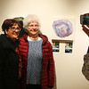 "Marcella Will, right, gets a photo taken with her daughter Julie Martinson in front of Will's Drip Pour painting, part of the ""Art of Alzheimer's Disease"" exhibit at the IUK art gallery inside the student center on Wednesday, Jan. 16, 2019. Will, a Waterford Place resident, was part of art therapy classes with other residents, and created the art on display.<br /> Kelly Lafferty Gerber 