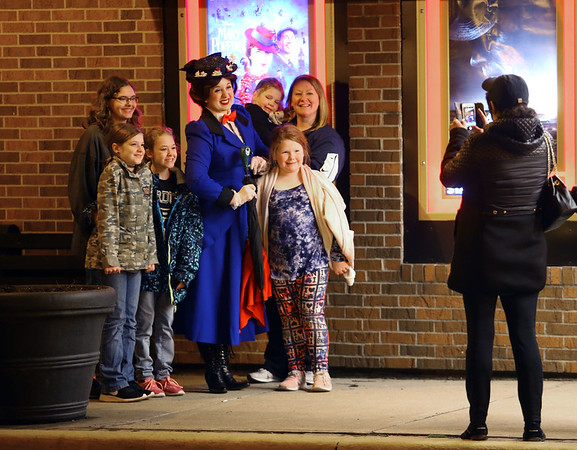 "Mary Poppins, from Royal Events, visited with movie-goers before the Saturday night showing of ""Mary Poppins Returns"" at the Diana Theatre in Tipton on Saturday, Jan. 5, 2018. Kelly Lafferty Gerber 
