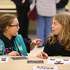 10-year-olds Rachel Rath, left, and Danielle Eilers, both from Tropp 480 in Russiaville, chat as they make phases of the moon using oreos at one of the stations set up at IUK for local Girl Scouts to earn their Space Science badges on Thursday, Jan. 17, 2019.<br /> Kelly Lafferty Gerber | Kokomo Tribune