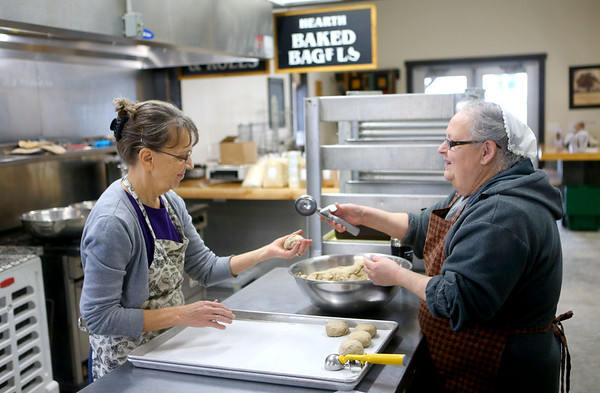 Naomi Stites, left, and Ruth Herschberger work together to make sandwich buns in the kitchen of Homestead Market, at 5254 County Road N. 500 E., as they prepare on Wednesday, Jan. 9, 2018, for their grand opening on Saturday. Kelly Lafferty Gerber | Kokomo Tribune