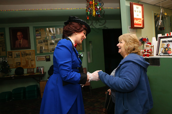 """Mary Poppins, played by Megan Bates, chats with Jean Romack before the start of Saturday night's showing of """"Mary Poppins Returns"""" at Tipton's Diana Theatre on Jan. 5, 2019. Bates goes to birthday parties, festivals, and other events dressed like storybook characters or princesses for her business, Royal Events. Kelly Lafferty Gerber 