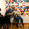 "Marcella Will kisses Roz Crowder on the forehead as the two Waterford Place residents and friends hold hands in front of the Wheelchair Mural on Wednesday, Jan. 16, 2019. The two women participated in an art therapy and their work is on display with others from the ""Art of Alzheimer's Disease"" exhibit at the IUK art gallery inside the student center.<br /> Kelly Lafferty Gerber 