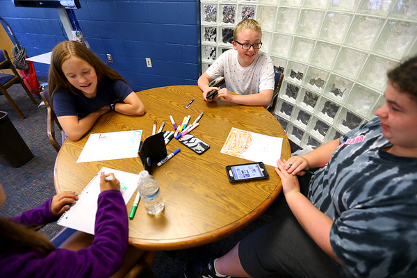 Bree Muncie Rylee Katter, Jack Tragesser and Abbie Riddle work on a project at the Tipton Boys and Girls Club on July 11, 2019. <br /> Tim Bath | Kokomo Tribune