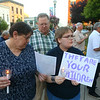 From left: Patricia Dixon, Chris Dixon, and Mary Rose Dixon sing with the group gathered at the Howard County Courthouse for Lights for Liberty, on Friday, July 12, 2019, to protest the conditions at migrant detention centers across the country. <br /> Kelly Lafferty Gerber | Kokomo Tribune