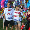 7-4-19<br /> Thursday's Haynes Apperson Festival<br /> Wearing their patriotic gear, Nick Rice and his fiancee Jeanne Long take in the sights of the Haynes Apperson Festival in Foster Park on July 4, 2019.<br /> Kelly Lafferty Gerber | Kokomo Tribune