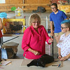 Traetin Richardson, 11, watches as cat show judge Joy Fabbri-Coombs plays with his cat Ninja during the cat show, on Friday, July 5, 2019, was one of the pre-fair activites of the Howard County 4-H Fair. Richardson and Ninja won reserve champion at the cat show.<br /> Kelly Lafferty Gerber | Kokomo Tribune