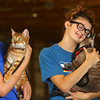 Nicole Ancil, 18, holds her cat Romeo as she waits for the final judging during the cat show on Friday, July 5, 2019. Ancil and Romeo were named grand champion of the cat show, one of the pre-fair activites at the Howard County 4-H Fair.<br /> Kelly Lafferty Gerber | Kokomo Tribune