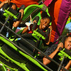 7-4-19<br /> Thursday's Haynes Apperson Festival<br /> Navaih Belcher, 7, center, and Micheal Wilford ride the Cliffhanger during the Haynes Apperson Fesitval on Thursday, July 4, 2019.<br /> Kelly Lafferty Gerber | Kokomo Tribune