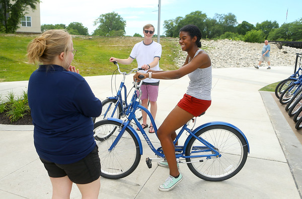 Yemisi Serrano, center, and Michael Kaster chat with Koko-Go rental agent Sarah Shutt before taking off on the trail with their bikes from Koko-Go Free Ride, the city's new free bike-sharing program at 307 S. Main St. on Wednesday, July 3, 2019.<br /> Kelly Lafferty Gerber | Kokomo Tribune