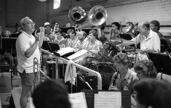 Tom Gustin, left, conducts the Peru Circus band in 1990. Gustin has been part of the Peru Circus for all of it's 60 years. <br /> Kokomo Tribune file photo