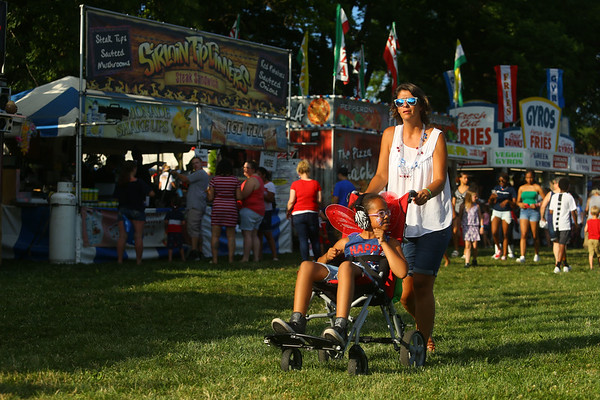 Alicia Rodda and her 7-year-old daughter Talia Banks, show off their 4th of July style as they meander through the Haynes Apperson Festival in Foster Park on July 4, 2019.<br /> Kelly Lafferty Gerber | Kokomo Tribune