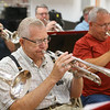 Rex Stitsworth plays the trumpet during band practice on July 3, 2019. Stitsworth and fellow band member Tom Gustin have been part of the Peru Circus band since its first year, 60 years ago.<br /> Kelly Lafferty Gerber | Kokomo Tribune