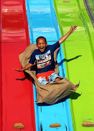 Deshawn Green, 5, takes a ride on the Super Slide during the Haynes Apperson Festival on Thursday, June 28, 2018.<br /> Kelly Lafferty Gerber | Kokomo Tribune