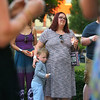 """6-year-old Jude Sibrary stands with family friend Taylor Doucette during Lights for Liberty, """"A vigil to end human concentration camps,"""" on Friday, July 12, 2019. Participants walked from Sol House to the Howard County Courthouse to protest the conditions at migrant detention centers across the country. <br /> Kelly Lafferty Gerber 
