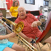 Tom Gustin, right, mentors 11-year-old Macy Buck with the trombone during Peru Circus band practice on July 3, 2019. Gustin and fellow band member Rex Stitsworth have been part of the Peru Circus band since its first year, 60 years ago.<br /> Kelly Lafferty Gerber | Kokomo Tribune