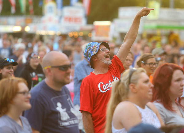 7-4-19<br /> Thursday's Haynes Apperson Festival<br /> Bobby Carrico cheers for Quiet Riot in Foster Park during the Haynes Apperson Festival on Thursday, July 4, 2019.<br /> Kelly Lafferty Gerber | Kokomo Tribune