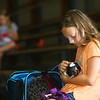 Meredith Kelly, 11, pets her guinea pig, Spice, as she waits in the bleachers for the final results of the small animal show on Tuesday, July 2, 2019, one of the Howard County 4-H Fair's pre-fair activities.<br /> Kelly Lafferty Gerber | Kokomo Tribune