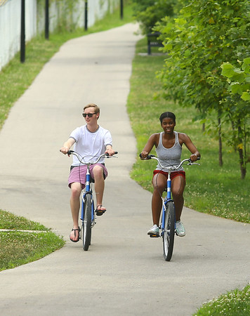 Michael Kaster, left, and Yemisi Serrano take to the trail after utilizing Koko-Go Free Ride, the city's new free bike-sharing program at 307 S. Main St., near The Foxes Trail, on Wednesday, July 3, 2019.<br /> Kelly Lafferty Gerber | Kokomo Tribune