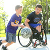 Alex Mula, right, plays defense as he shoots hoops with his 7-year-old brother Brady Mula at their home on May 8. Mula has played wheelchair basketball with a league out of Indianapolis for the past 10 years.<br /> Kelly Lafferty Gerber | Kokomo Tribune