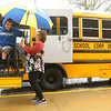 Mary Crume holds the umbrella over Northwestern senior Alex Mula as he gets on the bus to go home on a rainy school day on April 25, 2019.<br /> Kelly Lafferty Gerber | Kokomo Tribune