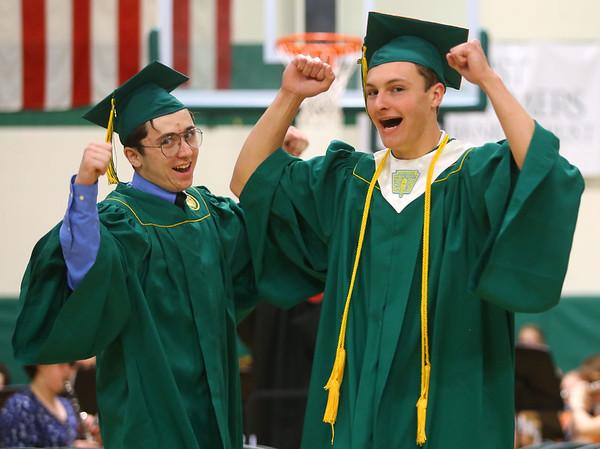 Nicholas Hillman, left, and Joseph Hawes enter Eastern's gym for the 2019 Eastern High School graduation on Sunday, June 2, 2019.<br /> Kelly Lafferty Gerber   Kokomo Tribune