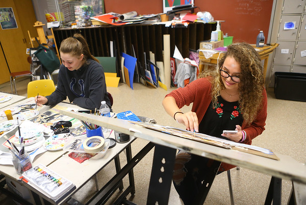 Tori Gilstrap, right, works on a painting in her art class at Taylor High School on April 23. Tori will be pursuing studio arts at Ball State after she graduates.<br /> Kelly Lafferty Gerber | Kokomo Tribune